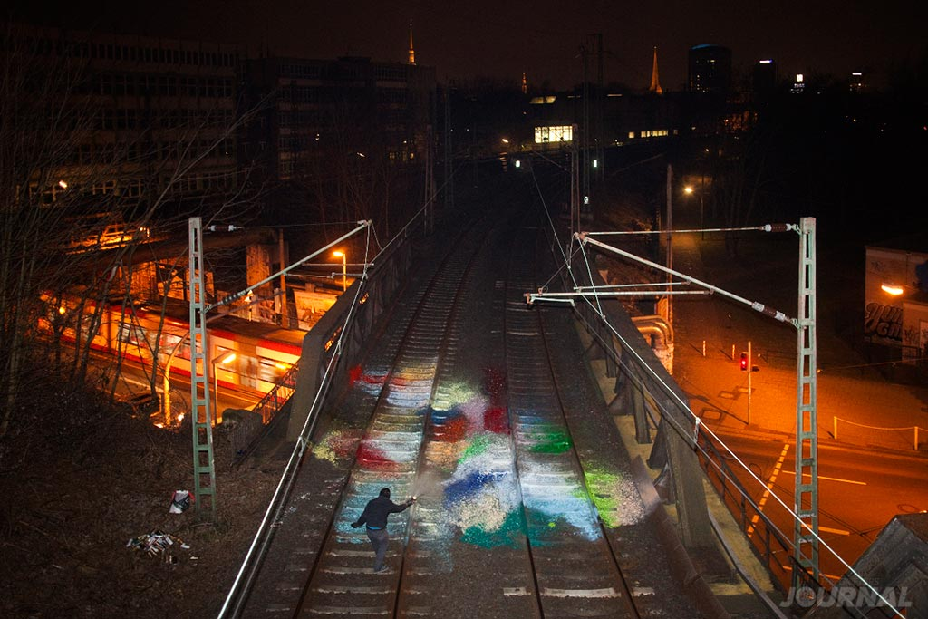 Paint splash on railway tracks by MOSES TAPS TOPSPRAYER The Grifter Journal